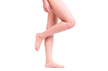 Side view of a beautiful naked legs of a woman walking isolated on a white background