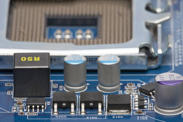 Electronic board. Shallow depth of field. In the blurred background, you can see the processor socket (CPU). Can be used as a background