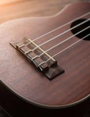 Ukulele guitar on table wood
