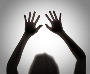 Silhouette of shadow of hands behind,blur image
