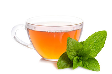 Glass cup of Tea with mint leaves  on table