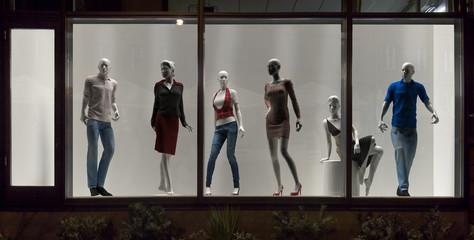 Mannequins in fashion shop, display window, interior design