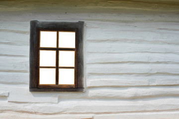 Old retro window with wooden shutters and wooden walls. vintage hut window