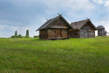 Old wooden house, an old hut in the field, outside the city of Kiev, Ukraine