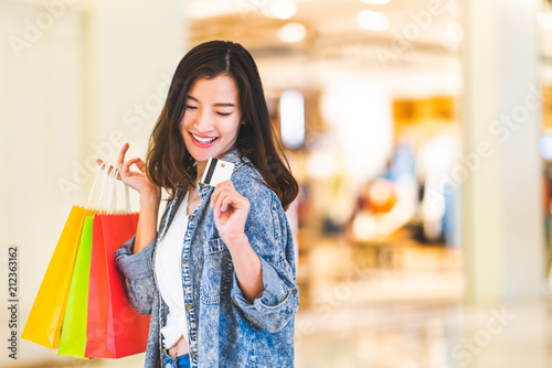 Happy Beautiful Asian Woman Smile At Credit Card Hold Shopping Bags