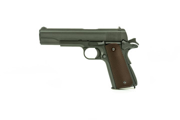 Profile view of isolated semi-automatic airsoft handgun. Replica of real handgun on white background.