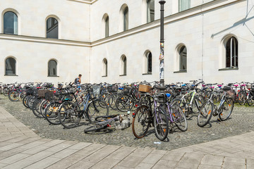 Munich, Germany June 09, 2018: The Ducal Georgianum (German: Herzogliches Georgianum) is a theological seminary of the Ludwig Maximilians University in Munich. Parked bikes next to the building.