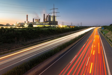 Long exposure sunset over German highway along power plant near Cologne in Germany
