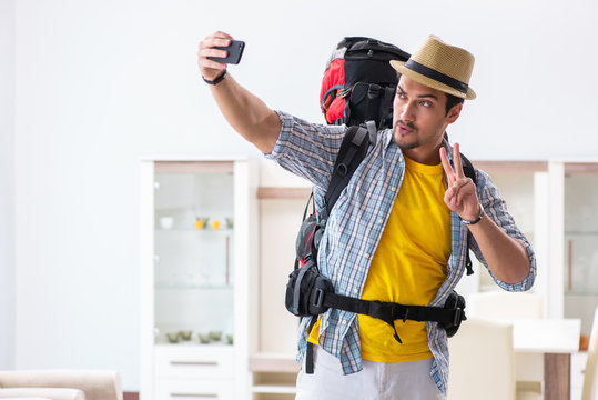 Backpacker packing for his trip