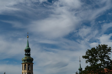 church tower with a blue sky with white clouds