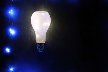 Glowing lightbulb on black background, idea concept