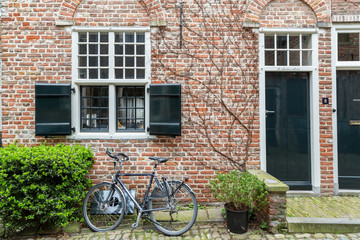 A Bike parked in Front of a Brick Building with Black Shuttered Windows and Door, Middelburg, Netherlands