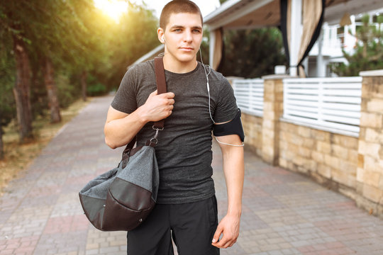 a man goes to training, an athlete with a bag in his hands, a morning run