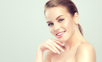 Beautiful young woman with clean fresh skin .Girl beauty face care. Facial treatment . Cosmetology , beauty and spa .