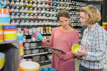 women looking at color palette in housewares hypermarket