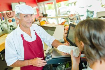 Serving a customer in a deli