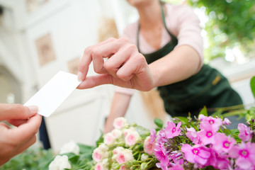 Florsit holding a buiness card