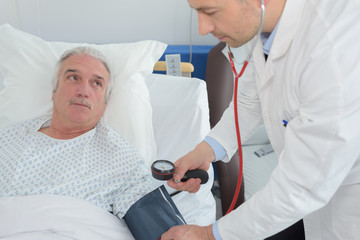doctor examining a senior patient