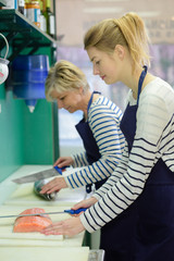 women preparing the fish