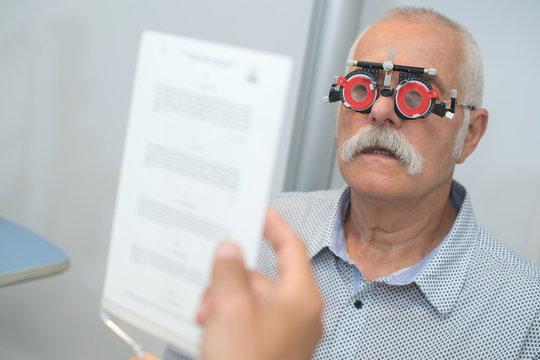 senior man patient under eyesight examination