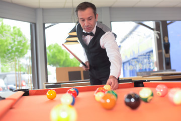portrait of a professional snooker playing