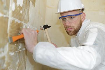 builder removing plaster
