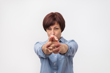 Dangerous european mature woman ready to shoot you down. She is confident about her decision