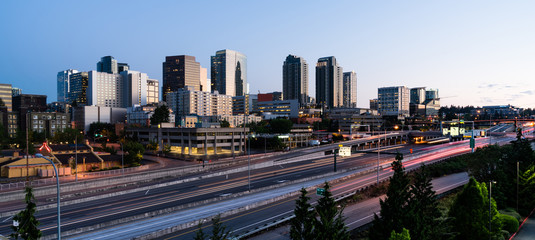 Early Morning Traffic Passes in front Of Buildings Reflecting Sunrise Light in Bellevue, Washington