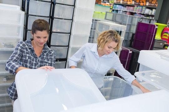 female friend buying plastic storage boxe
