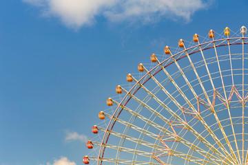 Tokyo giant ferris wheel against blue sky background