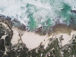 Wall Mural - Aerial view of tropical sandy beach and ocean with turquoise water.