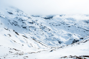 The stunning landscape of the snowy mountain on a foggy misty cloudy day. Kahurangi national park, New Zealand.