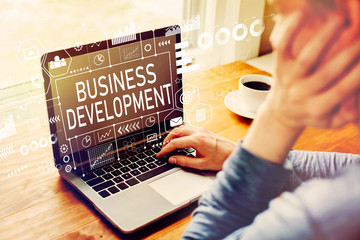 Business Development with man using a laptop computer