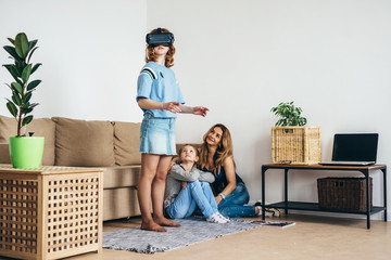 Child with virtual reality headset at home