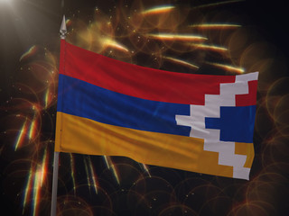 Flag of Artsakh Nagorno-Karabakh with fireworks display in the background
