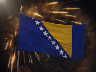 Flag of Bosnia and Herzegovina with fireworks display in the background