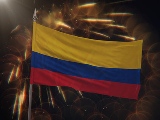 Flag of Colombia with fireworks display in the background