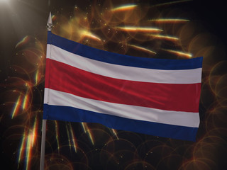 Flag of Costa Rica with fireworks display in the background