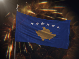 Flag of Kosovo with fireworks display in the background