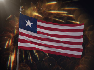 Flag of Liberia with fireworks display in the background