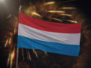 Flag of Luxembourg with fireworks display in the background
