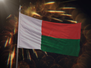 Flag of Madagascar with fireworks display in the background