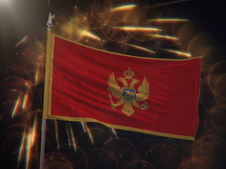 Flag of Montenegro with fireworks display in the background