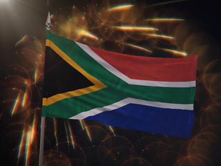 Flag of South Africa with fireworks display in the background