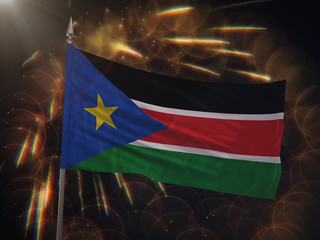 Flag of South Sudan with fireworks display in the background