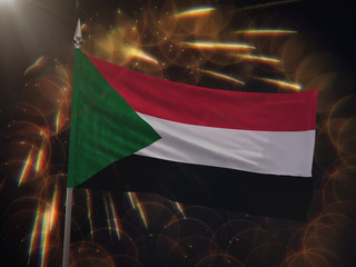 Flag of Sudan with fireworks display in the background
