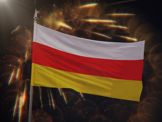 Flag of South Ossetia with fireworks display in the background