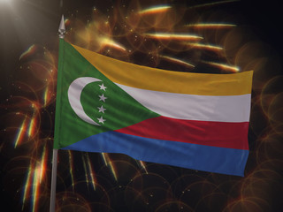Flag of the Comoros with fireworks display in the background