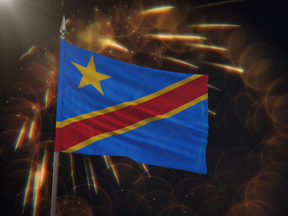 Flag of the Democratic Republic of the Congo with fireworks display in the background