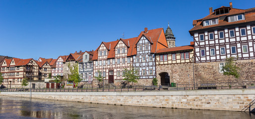 Panorama of colorful houses at the Fulda riverside in historic Hannoversch Munden, Germany Wall mural